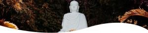 Buddhista szobor virágokkal
